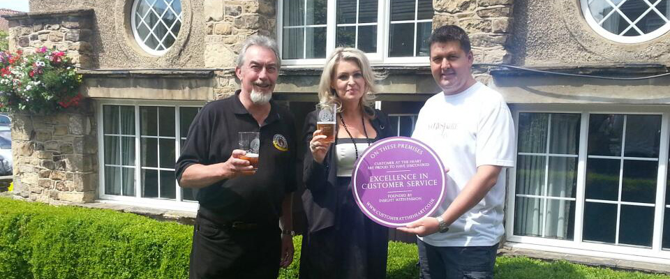 Kate Hardcastle presents the Collingham Beer Festival organisers with a plaque stating excellence in customer service
